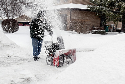 Sarah Nader- snader@shawmedia.com Howard Silverblatt uses a snow blower to clear his drive way at his McHenry home after around 3 inches of snow fell Saturday, February 1, 2014. A winter storm warning that was expected to be in effect until 6 p.m., was canceled at 11:15 a.m Saturday. The National Weather Service said it had a report of 3.1 inches of snow about 11 a.m. in Bull Valley with a possible inch more to fall during the afternoon hours.