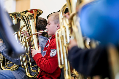 Sarah Nader- snader@shawmedia.com Seventh-grader Cooper Schmidt, 12, plays the tuba during band practice at Cary Junior High School Monday, February 3, 2014. Even though this school year District 26 brought back art and music to daily instruction, it did not bring back the Cary Junior High Band. The void had been filled by the Cary Band Association, which provides lessons for students at a cost.