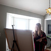 Artist Kerri Branson works on a painting in the studio of her North Aurora home.(Sandy Bressner photo)