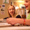 Olivia Henry, 9, (left) and Rebecca Ford, 10, share a laugh during a class at the Art Box in Geneva.(Sandy Bressner photo)