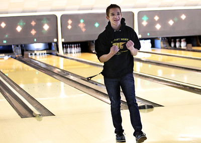 Monica Maschak - mmaschak@shawmedia.com Little Brother Alexander Jahn celebrates after bowling a spare during the Bowl for Kids' Sake event on Sunday, February 24, 2013. Big Brothers Big Sisters of McHenry County holds this annual fundraiser to help children who face adversity.