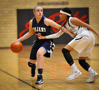 Randy Stukenberg - For the Northwest Herald Cary Grove sophomore Katie Barker tgries to drive around Sgtreamwood's Kimberly Jimenez in the first quarter of the Class 4A Rockford East Sectional Monday, Feb. 18, 2013  Story Slug: nwh.021913.sprts.CGgirls