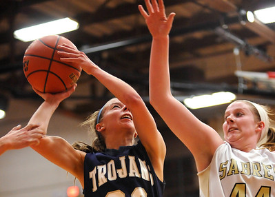 Randy Stukenberg - For the Northwest Herald Cary Grove senior Megan Leisten puts up a shot over Streamwood's Hannah McGlone in the third quarter of the Class 4A Rockford East Sectional Monday, Feb. 18, 2013.  Story Slug: nwh.021913.sprts.CGgirls