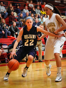 Randy Stukenberg - For the Northwest Herald Cary Grove senior Megan Leisten drives to the basket past Streamwood's Jessica Cerda in the third quarter of the Class 4A Rockford East Sectional Monday, Feb. 18, 2013  Story Slug: nwh.021913.sprts.CGgirls