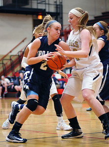 Randy Stukenberg - For the Northwest Herald Cary Grove sophomore Katie Barker drives past Steamwood's Natalie Filippo in the second quarter of the Class 4A Rockford East Sectional Monday, }Feb. 18, 2013.  Story Slug: nwh.021913.sprts.CGgirls