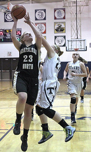 Monica Maschak - mmaschak@shawmedia.com Grayslake North's Joanna Guhl jumps for a score attempt in the third quarter of the Fox Valley Conference crossover game at Cary-Grove High School on Friday, February 8, 2013. Grayslake North lost to Cary-Grove 56-48.