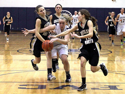 Monica Maschak - mmaschak@shawmedia.com Team Captain Katie Barker, surrounded by Grayslake North guards, fights for control of the ball in the last quarter of the Fox Valley Conference crossover game at Cary-Grove High School on Friday, February 8, 2013. The Trojans won 56-48.