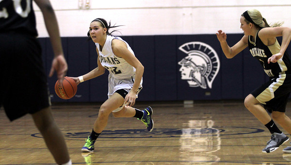 Monica Maschak - mmaschak@shawmedia.com Joslyn Nicholson eyes her defenders in the final quarter of the Fox Valley Conference crossover game against Grayslake North at Cary-Grove High School on Friday, February 8, 2013. The Trojans won 56-48.