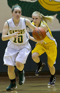 Brett Moist/ For the Northwest Herald   Crystal Lake South's Stephanie Oros (10) drives past Jacob's Lauren Van Vlierbergen (11) during the 2nd quarter of gameplay at Crystal Lake South on Tuesday. Crystal Lake South defeated Jacobs 54-44.