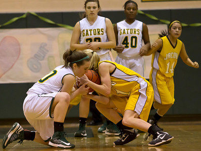 Brett Moist/ For the Northwest Herald     Crystal Lake South's Stephanie Oros (10) fights for the ball with Jacobs Lauren Van Vlierbergen (11) during the fourth quarter of gameplay at Crystal Lake South on Tuesday. Crystal Lake South defeated Jacobs 54-44.