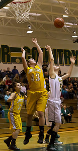 Brett Moist/ For the Northwest Herald  Crystal Lake South's Michelle Fuchs (50) shoots a basket over Jacobs Jackie Bartolai (43) and Jennifer Barnec (34) during the first quarter of gameplay at Crystal Lake South on Tuesday. Crystal Lake South defeated Jacobs 54-44.