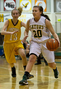 Brett Moist/ For the Northwest Herald   Crystal Lake South's Rachel Rasmussen (20) drives past Jacob's Victoria Tamburrino (13) during the first quarter of gameplay at Crystal Lake South on Tuesday. Crystal Lake South defeated Jacobs 54-44.