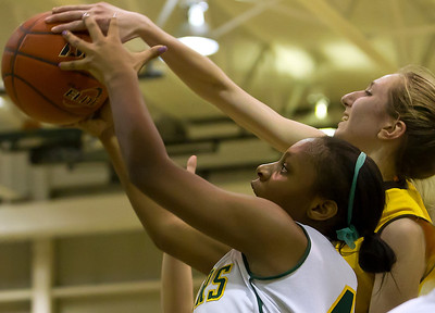 Brett Moist/ For the Northwest Herald    Crystal Lake South's Kianna Clark (40) fights for the ball with Jacobs Victoria Tamburrino (13) during the 1st quarter of gameplay at Crystal Lake South on Tuesday. Crystal Lake South defeated Jacobs 54-44.