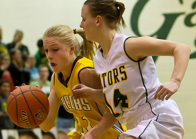 Brett Moist/ For the Northwest Herald       Jacobs Victoria Lauren Van Vlierbergan (11) drives past Crystal Lake South's Kelly Ryan (14) during the third quarter of gameplay at Crystal Lake South on Friday. Crystal Lake South defeated Jacobs 54-44.