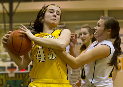 Brett Moist/ For the Northwest Herald    Jacob's Jackie Bartolai (43) fights for the ball with Crystal Lake South's Rachel Rasmussen (20) during the second quarter of gameplay at Crystal Lake South on Tuesday. Crystal Lake South defeated Jacobs 54-44.