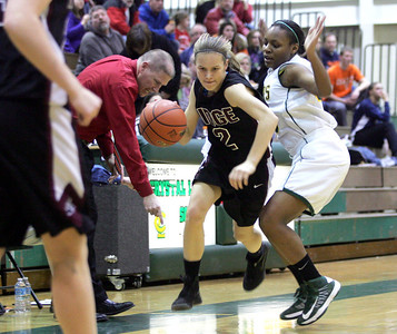 Monica Maschak - mmaschak@shawmedia.com Sarah LeBeau dribbles along the edge in the first quarter of the second round of the IHSA Regional Playoffs at Crystal Lake South on Wednesday, February 13, 2013. Crystal Lake South won 42-36.