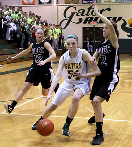 Monica Maschak - mmaschak@shawmedia.com Chanel Fanter makes her way to the hoop despite the defense in the second round of the IHSA Regional Playoffs at Crystal Lake South on Wednesday, February 13, 2013. Crystal Lake South won 42-36.