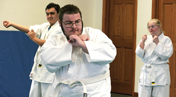 John Majewski competes with fellow SEDOM classmates for his first belt from the Flying Dragon Martial Arts Studio Tuesday Feb. 26, 2013.