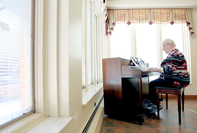 Sarah Nader - snader@shawmedia.com Volunteer Jane Hagenow of Woodstock plays the piano for residents at Hearthstone Manor while they enjoy lunch in Woodstock.