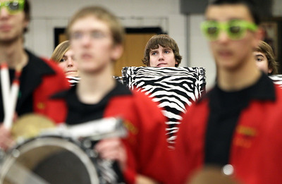 Monica Maschak - mmaschak@shawmedia.com Bass drummer Alec Berndt, with the Crystal Lake Strikers, awaits taking the court with the drum corps for a half-time performance at Crystal Lake Central High School on Wednesday, February 6, 2013. The Strikers is comprised of percussionists from Johnsburg, Huntely, Lake Zurich, Cary, Crystal Lake South, Crystal Lake Central and Prairie Ridge. On February 23, the group with perform at An Evening of Percussion at the Raue Center.