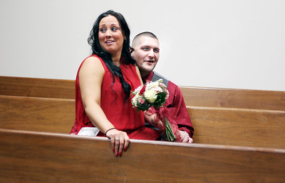 "Sarah Nader - snader@shawmedia.com Newleyweds Kyle and Nicole Averkamp share a quiet moment after being married on Valentine's Day at the McHenry County Courthouse. The two have been dating for just one year, but have known one another since middle school. They are expecting a baby in September. ""She grounds me. She's my anchor,"" Kyle, 26, said. ""We're best friends. You couldn't ask for anything better."""