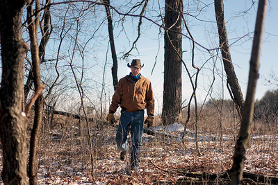 Sarah Nader - snader@shawmedia.com Volunteer Jeff Schumacher of Woodstock helps clear and burn debris and invasive plants while volunteering at the McHenry County Conservation District in Woodstock.