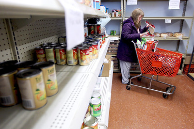 Sarah Nader - snader@shawmedia.com Linda Zeka of Harvard picks up groceries at the Harvard Food Pantry on Tuesday, February 12, 2013. According to the statewide poverty report the county's poverty rate jumped by about 5,000 people. from 5.5 percent to 6.9 percent. Harvard has a 26 percent poverty rate according to the census.