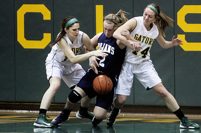 Sarah Nader - snader@shawmedia.com Crystal Lake South's Carly Nolan (left), Cary-Grove's Katie Barker and Crystal Lake South's Lauren Del Vecchio fight for control of the ball during the third quarter of Friday's Regional Championship in Crystal Lake on February 15, 2013. Cary-Grove won, 54-40.