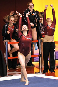 H. Rick Bamman - hbamman@shawmedia.com Prairie Ridge's Rachael Underwood completes her final tumbling pass in the floor exercise to the delight of her teammates Friday, Feb. 15, 2013 at the IHSA State Gymnastics preliminaires at Palatine High School. Underwood scored 9.675 for her routine.