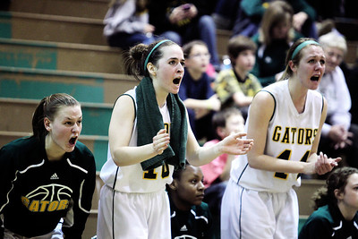 Sarah Nader - snader@shawmedia.com Crystal Lake South's Stephanie Oros (center) and Lauren Del Vecchio (right) cheer on their team during Friday's Regional Championship against Cary-Grove in Crystal Lake on February 15, 2013. Cary-Grove won, 54-40.
