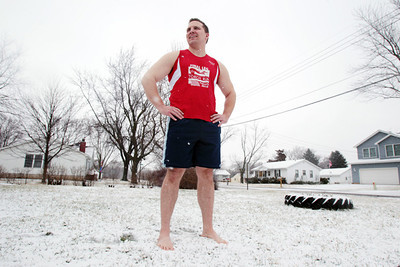 Sarah Nader - snader@shawmedia.com Josh Latina of Marengo poses for a portrait outside his home on Wednesday, January 30, 2013. Latina is raising money for the Special Olympics by participating in his fourth polar plunge at the end of February. He plans on jumping into Lake Michigan 24 times in 24 hours for the polar plunge.