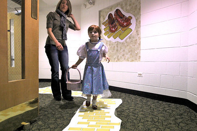 Monica Maschak - mmaschak@shawmedia.com Marianne Pacini, 6, walks down the yellow brick road to watch the Wizard of Oz in the downstairs portion of the Algonquin Public Library on Friday, February 2, 2013. Guests were able to sing along to the movie and win prizes for their creative costumes.