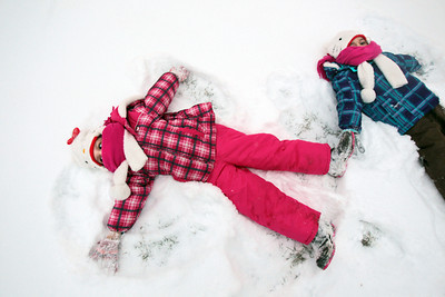 Sarah Nader - snader@shawmedia.com Esther Vilchis (left), 4, of Genoa and her sister, Liliana, 3, make snow angles after attending Woodstock's Groundhog Day Prognostication on February 2, 2013. To the delight of most in attendance, Willie prognosticated an early spring.