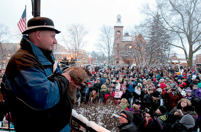 Sarah Nader - snader@shawmedia.com Handler Mark Szafran of Norridge presents Woodstock Willie to a crowd of about 500 Saturday morning on the Woodstock Square February 2, 2013. To the delight of most in attendance, Willie prognosticated an early spring.