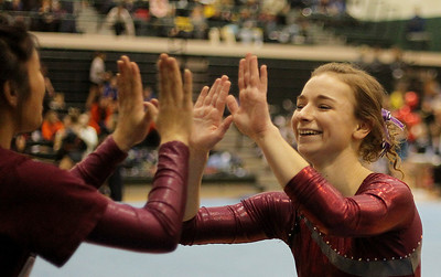 Sarah Nader - snader@shawmedia.com Prairie Ridge Coop's Savanna Mensching celebrates with a teammate after competing in vault during Monday's IHSA Gymnastics Sectional at Fremd High School on February 4, 2013.