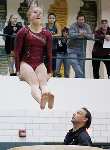 Sarah Nader - snader@shawmedia.com Prairie Ridge Coop's Jada Berkland competes in vault during Monday's IHSA Gymnastics Sectional at Fremd High School on February 4, 2013. Berkland finished third in the all around competition.