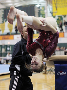Sarah Nader - snader@shawmedia.com Prairie Ridge Coop's Savanna Mensching competes in vault during Monday's IHSA Gymnastics Sectional at Fremd High School on February 4, 2013.