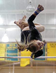 Sarah Nader - snader@shawmedia.com Jacobs' Allison Riedel competes in uneven parallel bars during Monday's IHSA Gymnastics Sectional at Fremd High School on February 4, 2013.