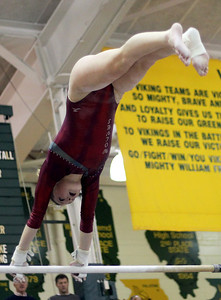 Sarah Nader - snader@shawmedia.com Prairie Ridge Coop's Riley Mahoney competes in uneven parallel bars during Monday's IHSA Gymnastics Sectional at Fremd High School on February 4, 2013.