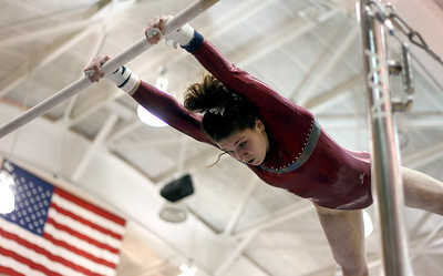 Sarah Nader - snader@shawmedia.com Prairie Ridge Coop's Rachael Underwood competes in uneven parallel bars during Monday's IHSA Gymnastics Sectional at Fremd High School on February 4, 2013.