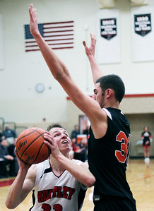 Sarah Nader - snader@shawmedia.com Huntley's Zach Gorney (left) tries to shoot over Crystal Lake Cental's Kyle Fleck  during the second quarter of Friday's game in Huntley on February 22, 2013. Crystal Lake Central won, 54-37.