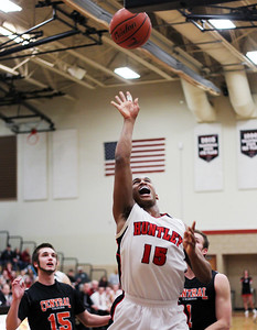 Sarah Nader - snader@shawmedia.com Huntley's Bryce Only makes a basket during the second quarter of Friday's game against Crystal Lake South on February 22, 2013. Crystal Lake Central won, 54-37.