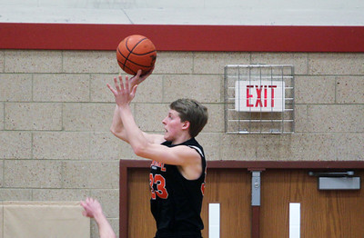 Sarah Nader - snader@shawmedia.com Crystal Lake Central's David Panicko makes a shot during the first quarter of Friday's game in Huntley on February 22, 2013. Crystal Lake Central won, 54-37.