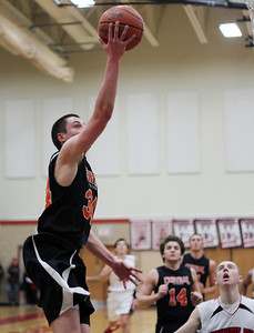 Sarah Nader - snader@shawmedia.com Crystal Lake Central's Jake VanScoyoc makes a shot during the third quarter of Friday's game in Huntley on February 22, 2013. Crystal Lake Central won, 54-37.
