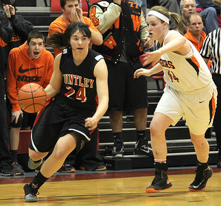 H. Rick Bamman - hbamman@shawmedia.com Huntley's Bethany Zornow (left) drives past Wheaton Warrenville South devender Olivia Linebarger in the fouth quarter of  Class 4A Dundee-Crown Supersectional Monday, Feb. 25, 2013. Huntley won 47-43.