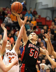 H. Rick Bamman - hbamman@shawmedia.com Huntley's Ali Andrews shoots past Wheaton Warrenville South devenders i the fouth quarter of  Class 4A Dundee-Crown Supersectional Monday, Feb. 25, 2013. Huntley won 47-43.