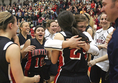 H. Rick Bamman - hbamman@shawmedia.com The Huntley Red Raiders celebrate their victory over Wheaton Warrenville South in the Class 4A Dundee-Crown Supersectional Monday, Feb. 25, 2013. The Huntley girls basketball team beat Wheaton Warrenville South, 47-43, on Monday to reach the state finals for the first time.
