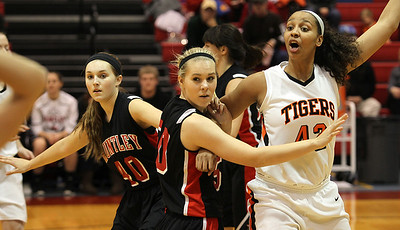 H. Rick Bamman - hbamman@shawmedia.com Huntley defenders Sam Andrews (left) and Ali Andrews double team Wheaton Warrenville South's Diamond Thompson in the Class 4A Dundee-Crown Supersectional Monday, Feb. 25, 2013. Huntley won 47-43.