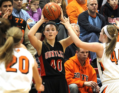H. Rick Bamman - hbamman@shawmedia.com Huntley's Sam Andrews (40) looks for an open teammate while Wheaton Warrenville South's Kelly Langlas (20) and Olivia Linebarger (44) defend in the Class 4A Dundee-Crown Supersectional Monday, Feb. 25, 2013. Huntley won 47-43.