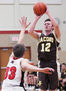 Sarah Nader - snader@shawmedia.com Jacobs' Jon Berndt shoots over Huntley's Zach Gorney during the first quarter of Tuesday's game at Huntley High School on February 12, 2013. Huntley won, 54-26.